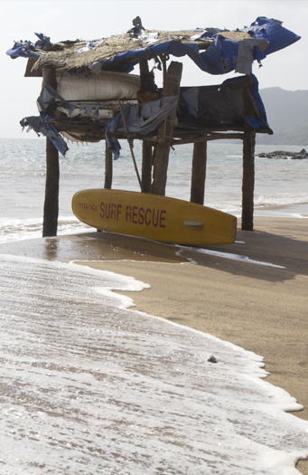 Beach in Goa with surf rescue surfboard